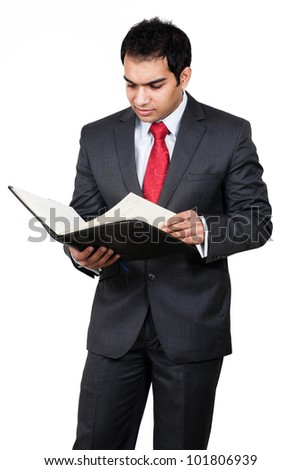 Young Indian businessman reading his appointments from year planner