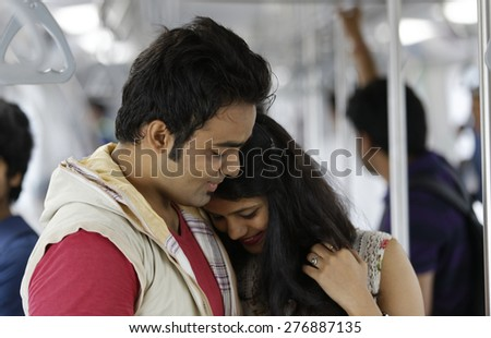 Young Indian Couple inside Metro train.
