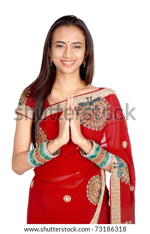 Young Indian girl in traditional clothing. Isolated on a white background. - stock photo