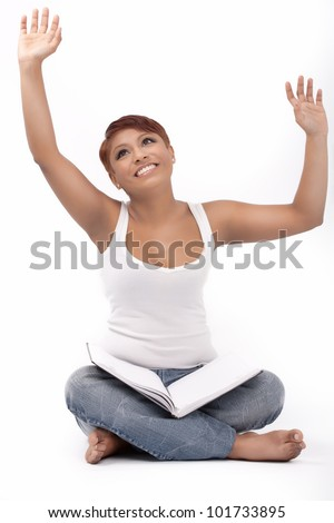 Young indian girl rejoice looking at her diary - stock photo