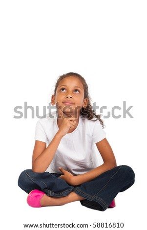 young indian girl sitting on floor daydreaming - stock photo