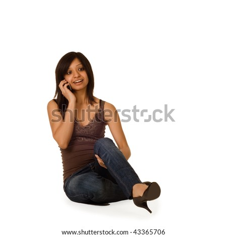 Young Indian girl talking on the phone - stock photo