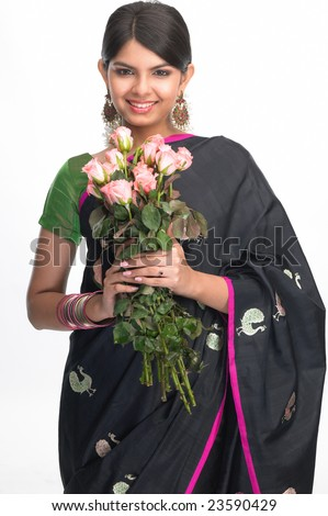 Young indian girl with  bunch of pink roses - stock photo