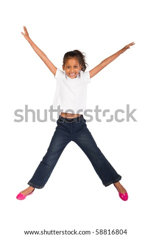 young indian kid jumping high - stock photo