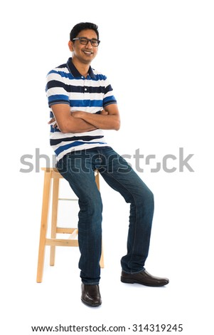 young indian male sitting - stock photo