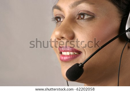 Young Indian Operator at a Call center - stock photo