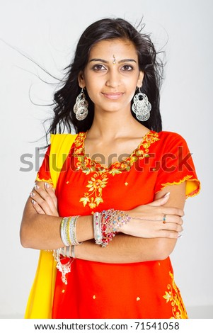 young indian woman in traditional sari studio portrait - stock photo