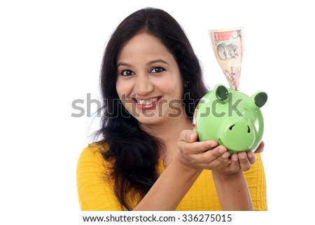 Young Indian Woman Saves Money in Piggy bank