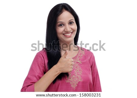 Young Indian woman showing thumbs up gesture against white