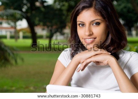 young indian woman smiling - stock photo