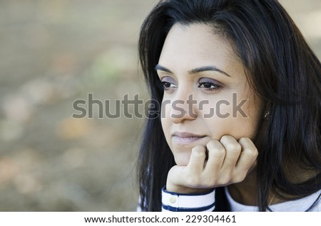 Young Indian woman thinking over her issues - stock photo