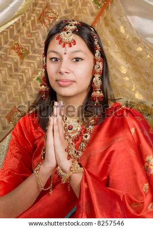 Young Indian woman wearing saree and bridal jewelry - stock photo
