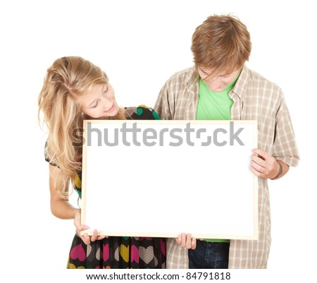 young interested couple holding blank billboard, poster - stock photo