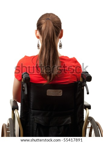 young invalid woman in red blouse on the wheelchair - stock photo