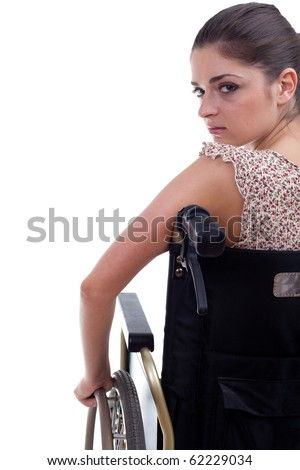 young invalid woman on the wheelchair, isolated - stock photo