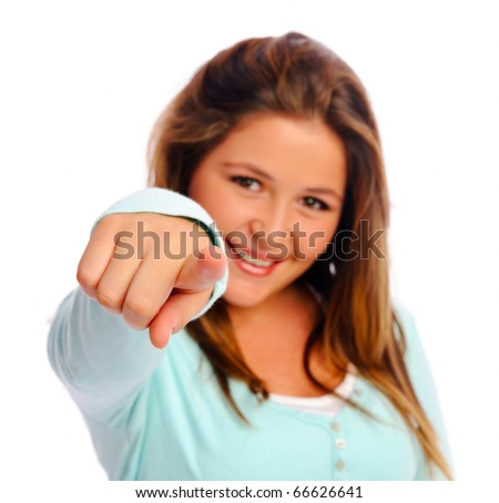 Young isolated teenager points into the camera - stock photo