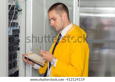 Young IT consultant working in a server room