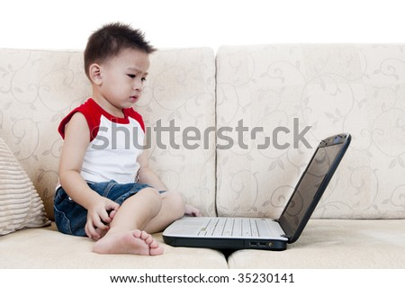 Young IT user. Young Asian concentrate looking at laptop screen. - stock photo