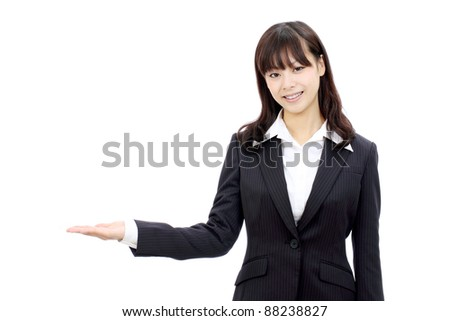 Young japanese business woman hand showing blank sign - stock photo