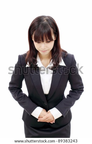 Young japanese business woman making apology - stock photo