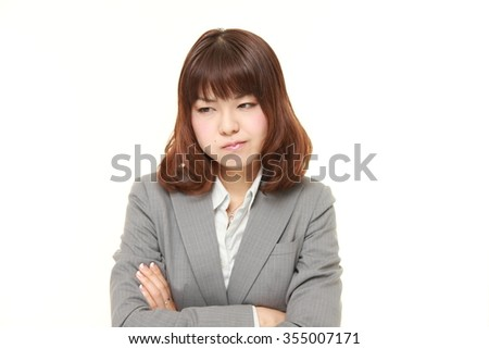 young Japanese businesswoman in a bad mood - stock photo