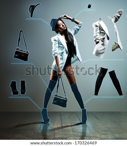 Young japanese fashion woman with chart of clothes. - stock photo