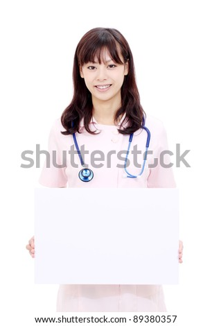 Young japanese female nurse holding a blank white board - stock photo