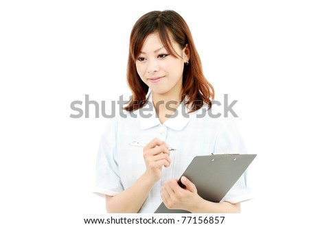 Young japanese female nurse with clipboard - stock photo