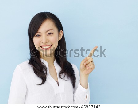 Young japanese girl isolated on blue background