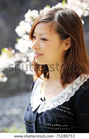 Young japanese girl, outdoor portrait - stock photo