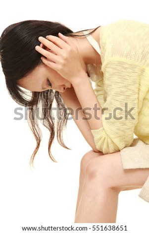 young Japanese woman depressed