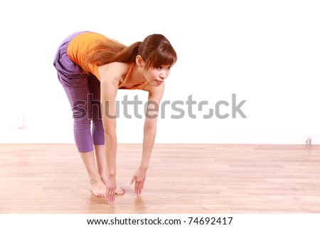 "Young Japanese Woman Doing YOGA ""standing forward bend pose"""
