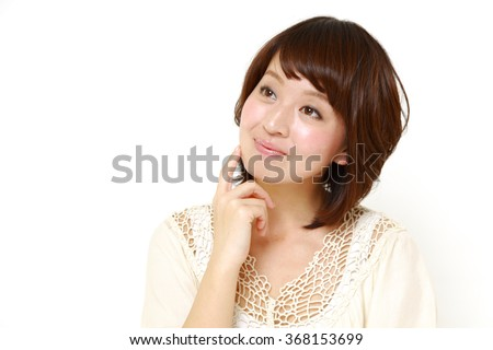 young Japanese woman dreaming at her future - stock photo