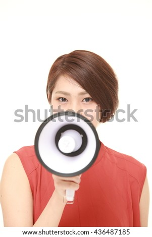 young Japanese woman in a red shirts with megaphone