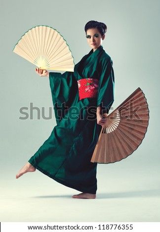 Young japanese woman with fans. - stock photo