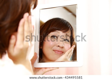 young Japanese woman with good condition skin