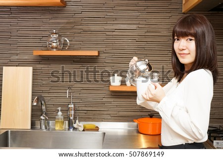 Young Japanese woman working at  a cafe