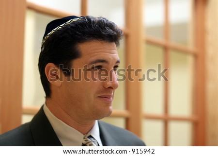 Young jewish man in yarmulke - stock photo
