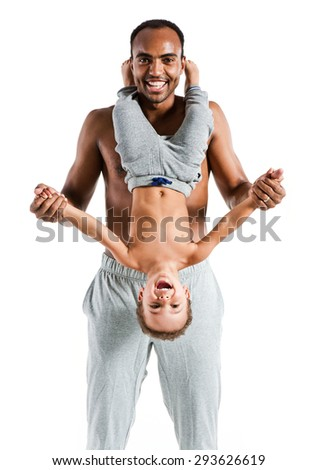 Young joyful father having fun with his child, family and father's day concept / photo set of sporty muscular Hispanic shirtless fitness man with his son over white background - stock photo