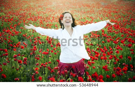 Young joyful woman in spring field - stock photo