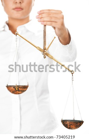 Young judge holding scales in isolation - stock photo
