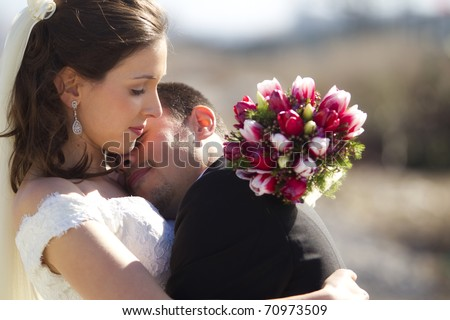 Young just married couple in romantic embrace. - stock photo