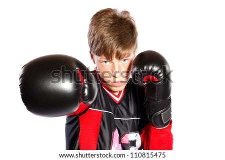 young kick boxer on white background, focus on face - stock photo