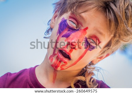 young kid - boy - with painted face, child zombie face art - stock photo