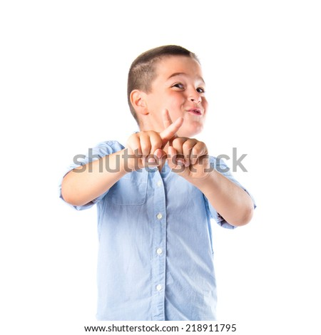 Young kid doing NO gesture over white background  - stock photo