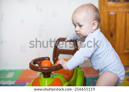 Young kid driving a race car - stock photo