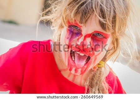 young kid - girl - with painted face, child zombie face art - stock photo