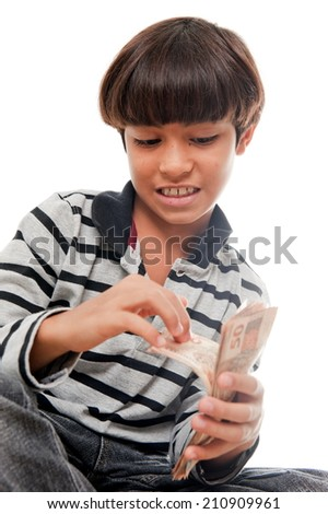 Young kid holding and counting a lot money