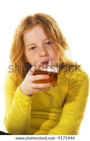 Young kid is drunk while drinking alcohol - stock photo