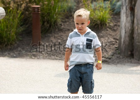Young kid is starring at something. - stock photo